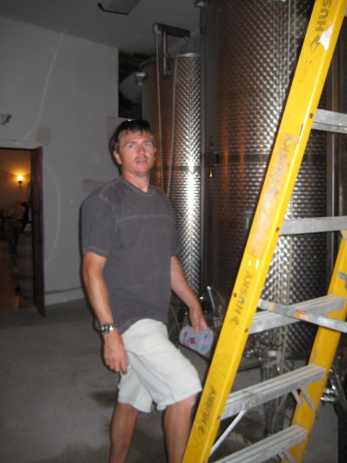 Todd Climbing up the Ladder to Filter the Chardonnay